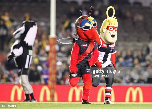 The Bombers mascot and Saints mascot compete in the Mascot Race during the EJ Whitten Legends game at Etihad Stadium on September 1 2017 in Melbourne...