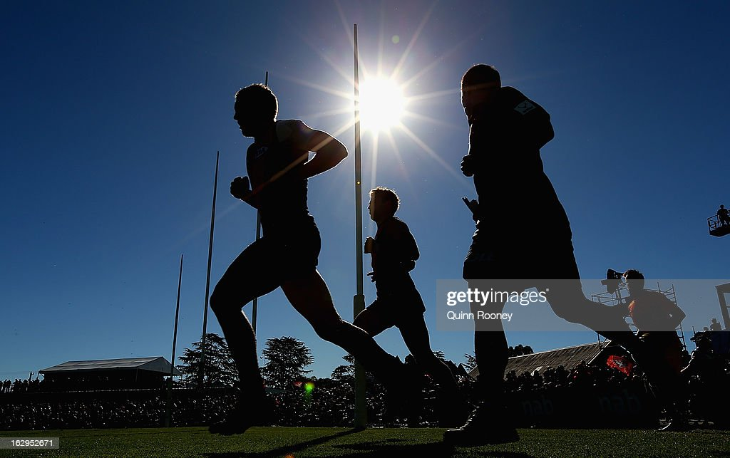The Bombers run out onto the field during the round two AFL NAB Cup match between the Essendon Bombers and the Richmond Tigers at Wangaratta Showgrounds on March 2, 2013 in Wangaratta, Australia.