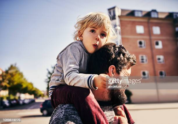 the bond between father and son - city stock pictures, royalty-free photos & images