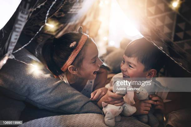 the bond between siblings - sheet stock pictures, royalty-free photos & images