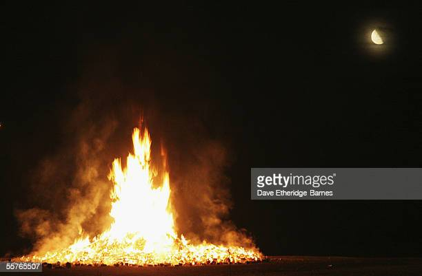 The bonfire and the moon are seen during the first of the Bonfire Night celebrations on September 24 2005 in Burgess Hill England Bonfire Night is...