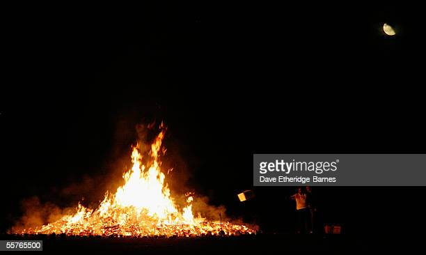 The bonfire and the moon aree seen during the first of the Bonfire Night celebrations on September 24 2005 in Burgess Hill England Bonfire Night is...