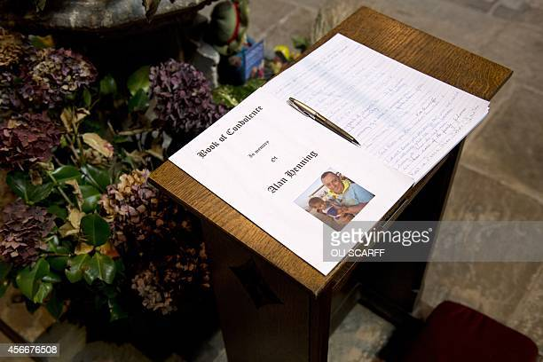 The book of condolence in memory of murdered aid worker Alan Henning is displayed in Eccles Parish Church in Eccles north west England on October 5...