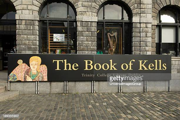 The Book of Kells banner advertising the outside the library of Trinity College in Dublin Ireland The oldest university in Ireland founded in 1592 by...