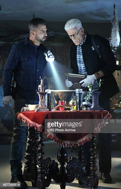 """The Book of Shadows"""" -- Nick Stokes left) and D.B. Russell focus in on a table with various items that belonged to chemistry teacher Chet Messner who..."""