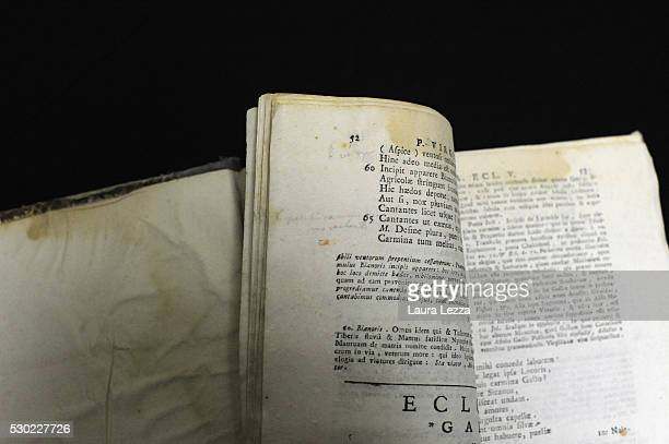 The book Opera Omnia of Virgilio with some glosses of handwriting that it is belived to be belonged to Amedeo Modigliani is displayed in a bank vault...