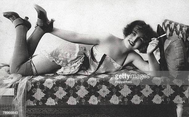 The Book Volume 1 Page Picture 3A Parisienne model smiles for the camera as she reclines on a chaise longue
