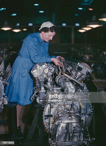 The Book, Volume 1, Page Picture November A women is pictured on the production line, making Rolls Royce aero engines,