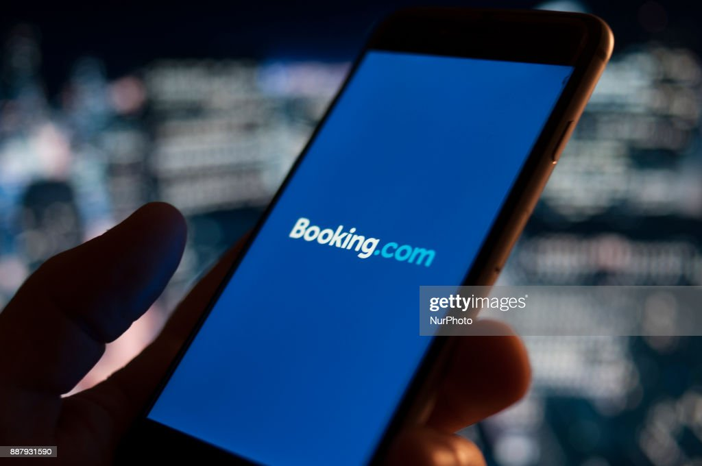 The Booking.com hotel reservations applications is seen on an iPhone on December 7, 2017.