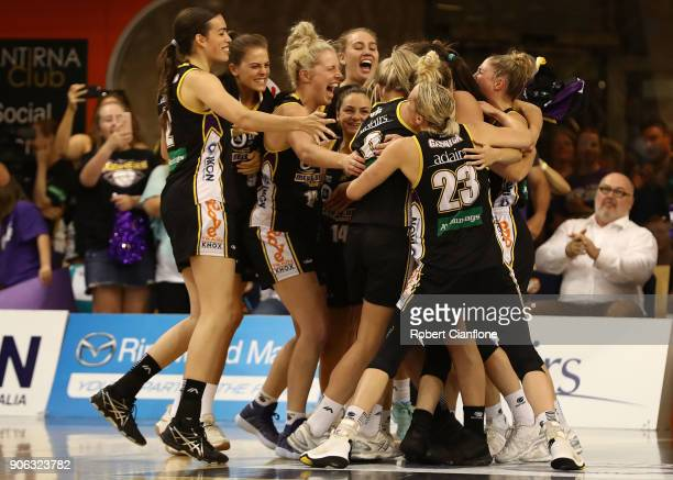 The Boomers celebrate aftey defeated the Fire during game two of the WNBL Grand Final series between the Melbourne Boomers and the Townsville Fire at...