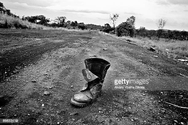 The boot of a dead FRDC soldier on the road between Kibati and Rusturu