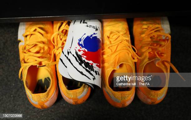 The boots and shin pads of Ji So-Yun of Chelsea are displayed inside the Chelsea dressing room prior to the FA Women's Continental Tyres League Cup...