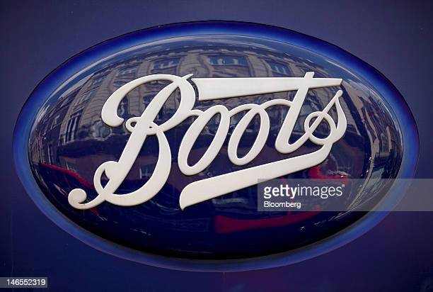 The Boots logo sits on a sign outside one of the company's stores operated by Alliance Boots in London UK on Tuesday June 19 2012 Walgreen Co the...