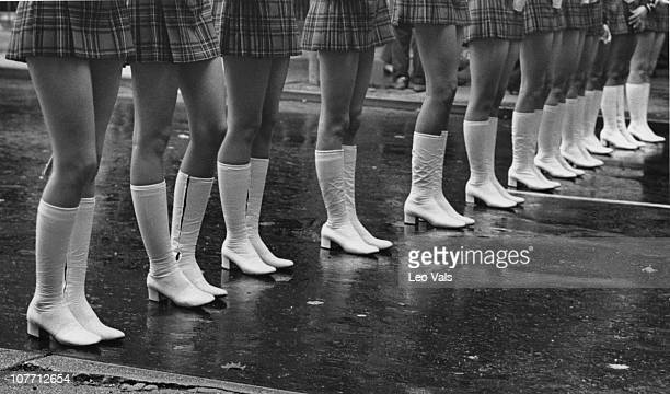 The boots of a group of majorettes taking part in a parade in the 1960's