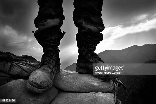 The boots of a soldier from the Afghan National Army Weapons Company 2¼ Kandak 3 Brigade 201 Corp based in Gowardehs OP 3 miles from the border with...