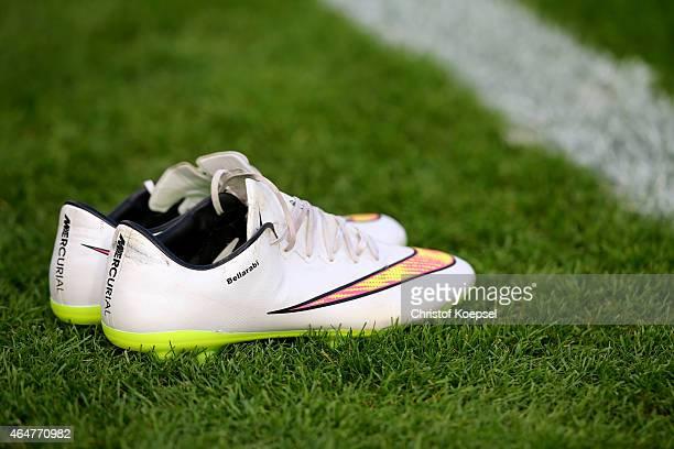 The boots of Karim Bellarabi of Leverkusen are seen prior to the Bundesliga match between Bayer 04 Leverkusen and SC Freiburg at BayArena on February...