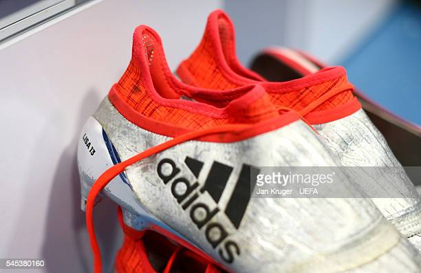 The boots worn by Thomas Mueller of Germany are seen in the dressing room prior to the UEFA EURO semi final match between Germany and France at Stade...