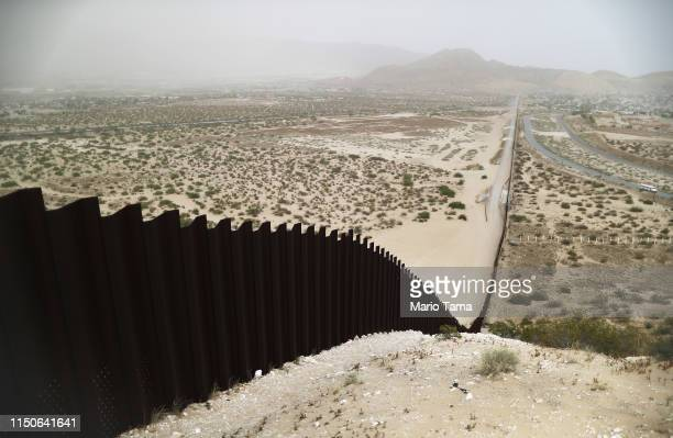 The border barrier between the US and Mexico runs down a hillside on May 20 2019 as taken from Ciudad Juarez Mexico Approximately 1000 migrants per...