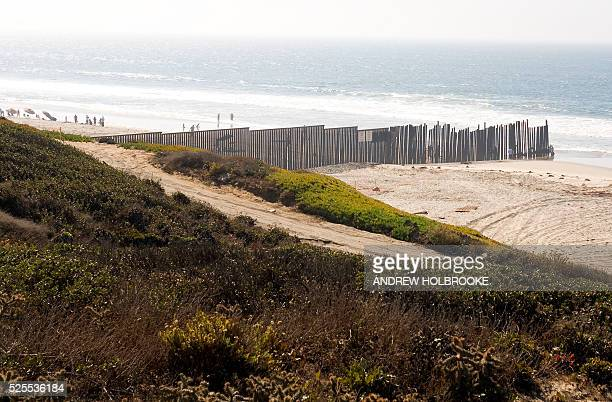 The border fence separating the United States and Mexico runs into the Pacific Ocean at Imperial Beach Seen from the American side