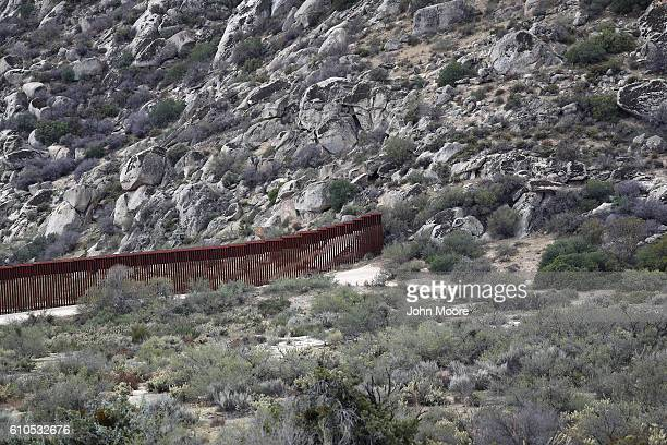 The border fence stops at a hillside on the USMexico border fence on September 26 2016 in Jacamba Hot Springs California The border stretches almost...