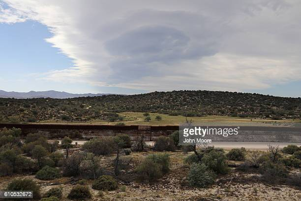 The border fence stretches along on the USMexico border fence on September 26 2016 in Jacamba Hot Springs California The border stretches almost 2000...