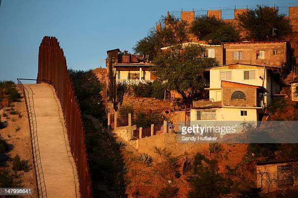 The border wall between the US and Mexico is seen July 6 2012 in Nogales Arizona The presidentelect of Mexico Enrique Peña Nieto stated that he wants...