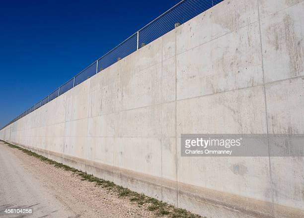 The border wall north of McAllen along the Texas/Mexico border in the Rio Grande Valley of Texas January 14 2014