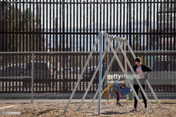 The border wall that separates the United States and Mexico towers over Miguel Cortez Park on January 25 2019 in Calexico California The US...