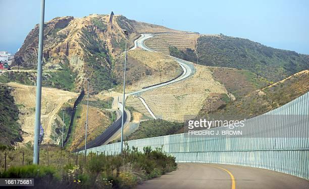 MACOR 'EEUUMIGRACIÓNSEGURIDADHISPANOS' The 'borderfence' runs along and through hillsides at Border Field State Park along the USMexico border across...