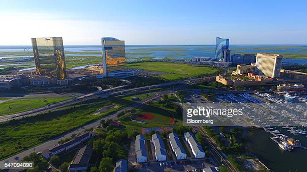 The Borgata Hotel Casino & Spa, from left, The Water Club, The Golden Nugget Inc., and Harrah's Waterfront Towers stand in this aerial photograph...