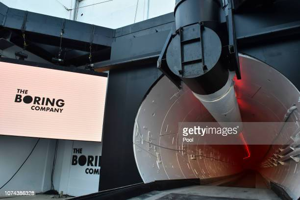 The Boring Company signage is displayed at the tunnel entrance before an unveiling event for The Boring Company Hawthorne test tunnel December 18,...