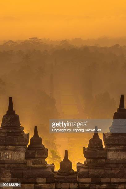 The Borobudur stupas with the morning fog scene in background, Central Java, Indonesia.