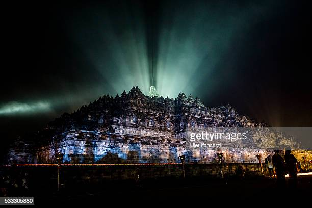 The Borobudur temple seen illuminated during celebrations for Vesak Day on May 22 2016 in Magelang Central Java Indonesia Vesak is observed during...