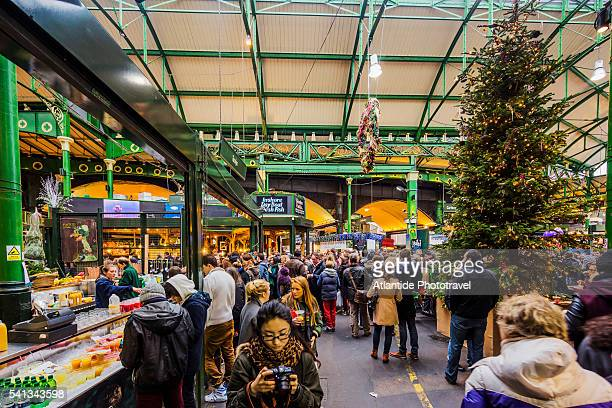 the borough market during the christmas period, people near a christmas tree - borough market stock pictures, royalty-free photos & images