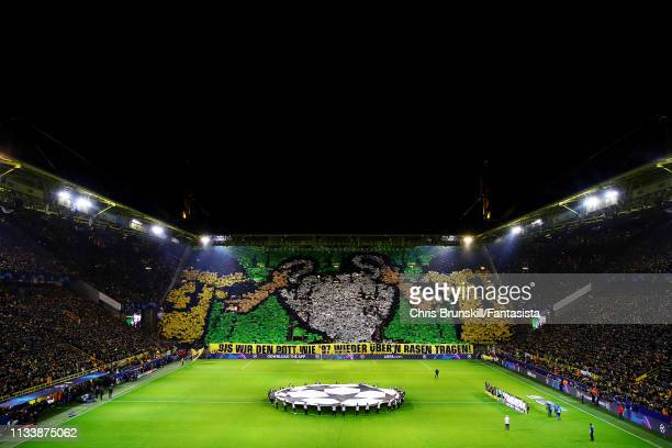 The Borussia Dortmund fans hold a banner to remember their UEFA Champions League win of 1997 before the UEFA Champions League Round of 16 Second Leg...