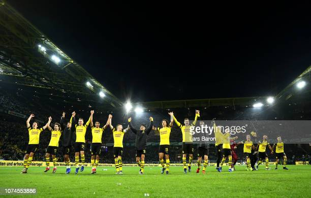 The Borussia Dortmund players celebrate in front of their fans following victory during the Bundesliga match between Borussia Dortmund and Borussia...