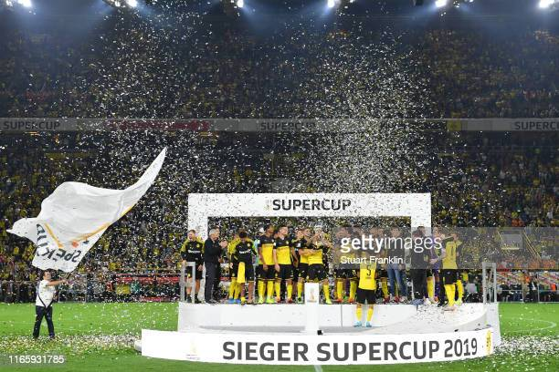 The Borussia Dortmund players celebrate with the DFL Supercup Trophy following their team's victory in the DFL Supercup 2019 match between Borussia...