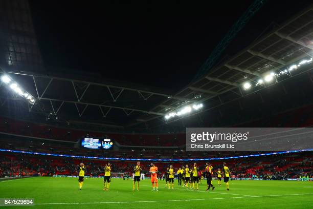 The Borussia Dortmund team applaud their supporters after the UEFA Champions League group H match between Tottenham Hotspur and Borussia Dortmund at...