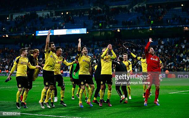 The Borussia Dortmund team celebrate with their fans on the pitch after the final whistle during the UEFA Champions League Group F match between Real...