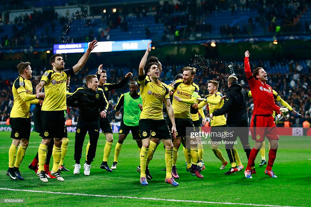 The Borussia Dortmund team celebrate with their fans on the pitch after the final whistle during the UEFA Champions League Group F match between Real Madrid CF and Borussia Dortmund at the Bernabeu on December 7, 2016 in Madrid, Spain.