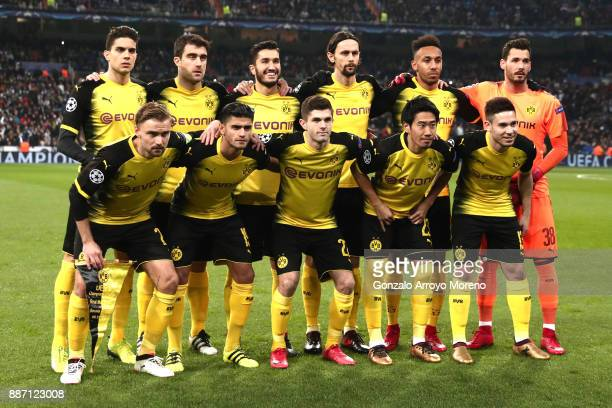 The Borussia Dortmund team pose for a team photo prior to the UEFA Champions League group H match between Real Madrid and Borussia Dortmund at...