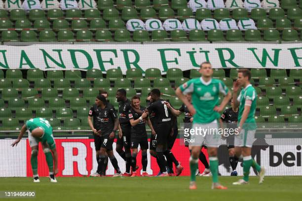 The Borussia Moenchengladbach squad celebrate their teams second goal scored by Marcus Thuram of Borussia Moenchengladbach during the Bundesliga...