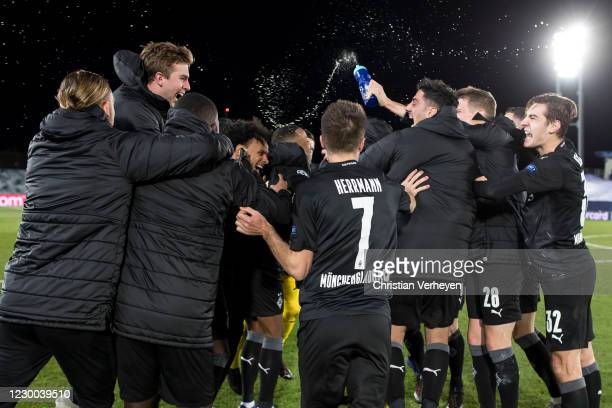 The Borussia Moenchengladbach team celebrates the qualification for the round of 16 in the UEFA Champions League after the Group B - UEFA Champions...