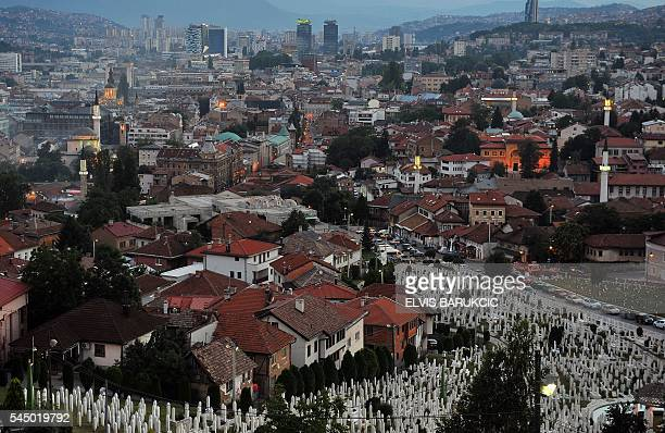 The Bosnian capital Sarajevo is seen from above while minarets of mosques are lit up on the final day of the Islamic holy month of Ramadan late on...