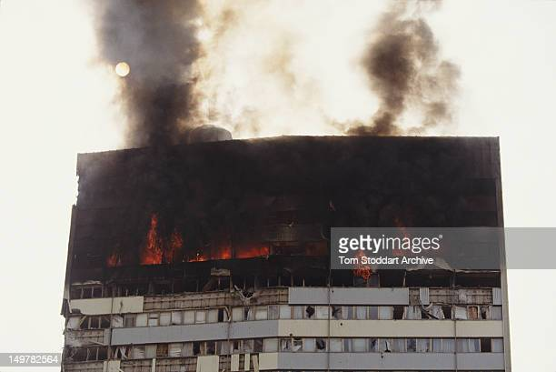 The Bosnian parliament building on fire after being hit by Serbian tank shells during the Siege of Sarajevo in the Bosnian War Bosnia September 1992