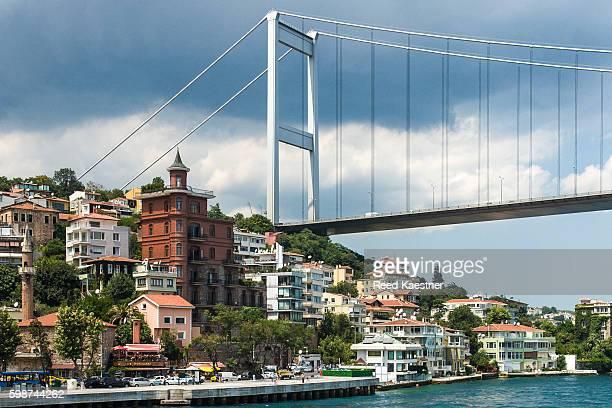 the Bosphorus Bridge towers over residential buildings on the Europe side of the Bosphorus, Istanbul, turkey