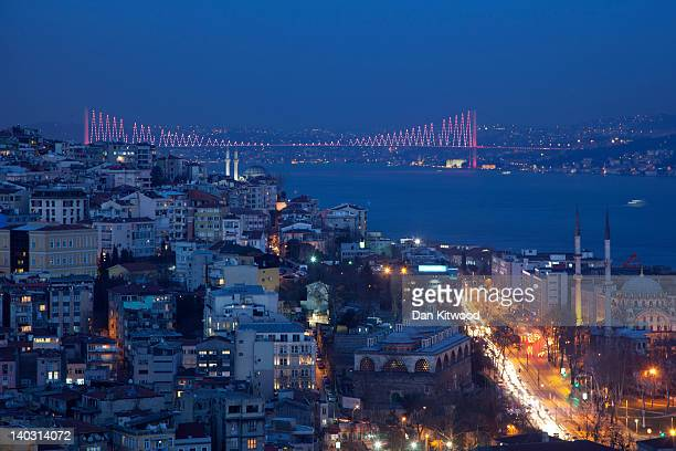 The Bosphorus Bridge which spans between the Asian and European sides of Istanbul lights up on February 20 2012 in Istanbul Turkey Though not the...