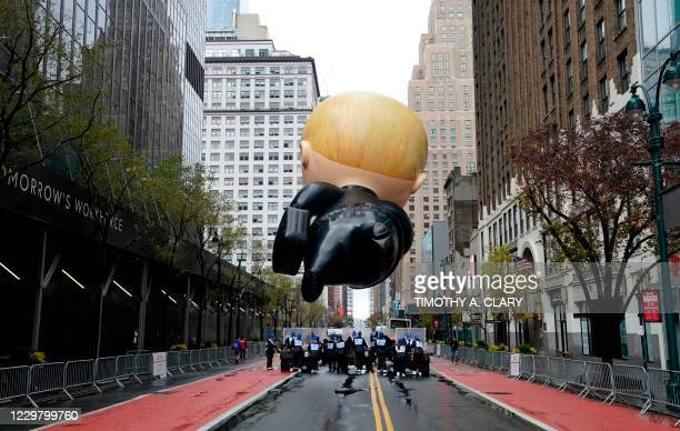 """The """"Boss Baby"""" balloon floats during the Macy's Thanksgiving Day Parade in New York November 26, 2020. - Due to the pandemic Macy's Thanksgiving..."""