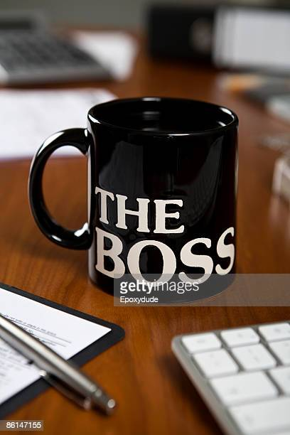 The Boss mug on a desk