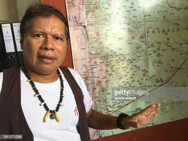 The boss of the airline Aero Sarayaku Jose Gualinga stands in his office at the airport of city of Shell Ecuador 27 October 2016 Around his neck is a...
